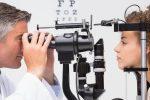 Woman doing eye test with optometrist